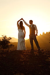 Bride and Groom twirl in the sunset