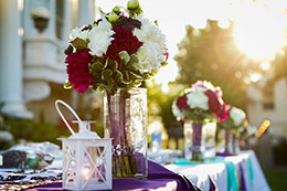 Beautiful wedding reception decorations in the sunset at Moore Mansion