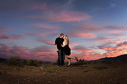 Engaged couple kiss under fierce Phoenix sky