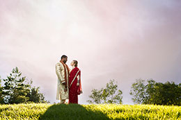 Eastern Indian wedding couple with darkening sky in Regina, Saskatchewan