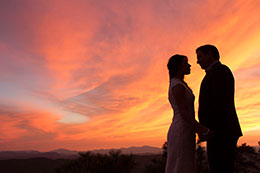Firery sunset wedding portrait at Mogollon Rim in Arizona