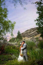 Bride and Groom kiss in the sunset at Thompson River University