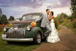 Bride and Groom beside a rustic GMC truck