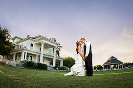 Big sky over wedding couple at Moore Mansion