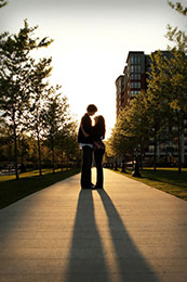 Engaged couples long shadows in Hoboken, New Jersey
