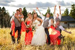 Wedding party strikes a crazy pose as the sun goes down