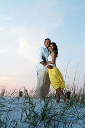 Engaged couple embrases as the sun sets in Destin, Florida