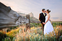 Wedding couple kisses with Scotts Bluff Monument in background