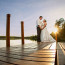 Bride & Groom pose on a dock at sunset at Cass Lake, Minnesota