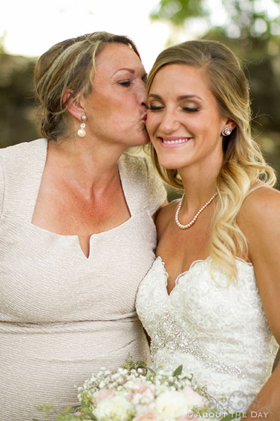Mother of the Bride kisses her daughter at Shadow Lake Ranch