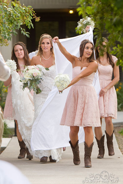 Bride is hidden from the audience by her sisters at Shadow Lake Ranch