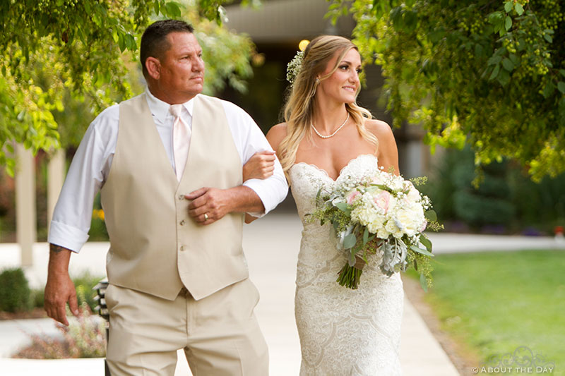 Father walks his daughter down the isle at Shadow Lake Ranch