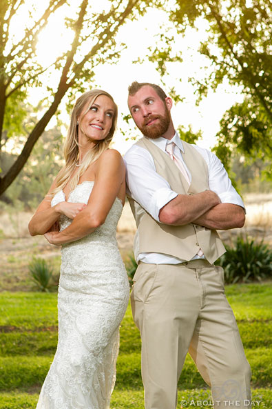 Bride and Groom have playful pose at Shadow Lake Ranch