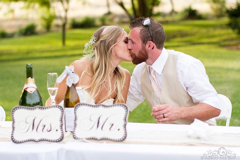 Bride and Groom kiss during reception at Shadow Lake Ranch
