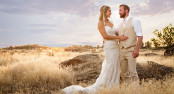 Bride and Groom pose in spectacular sunset