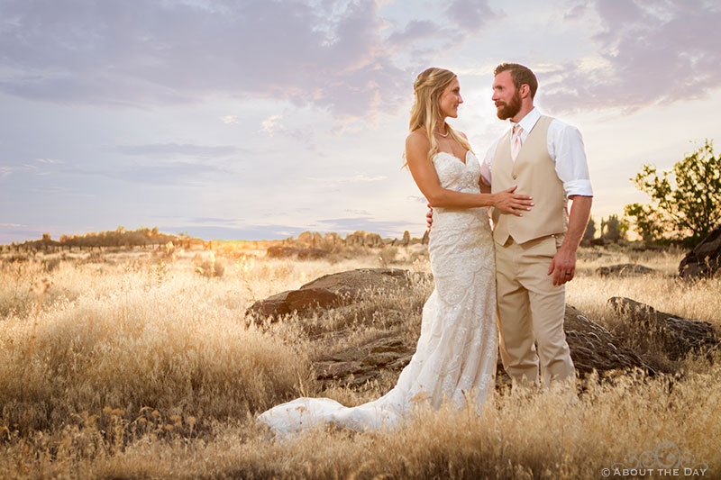 Bride and Groom pose in spectacular sunset at Shadow Lake Ranch