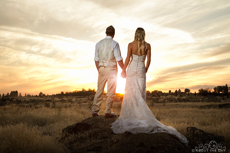 Bride and Groom look angelic during spectacular sunset at Shadow Lake Ranch