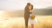Bride and Groom kiss in the sunset