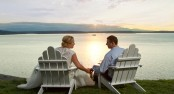 Bride and Groom sit and watch a glorious sundown in Seattle, Washington