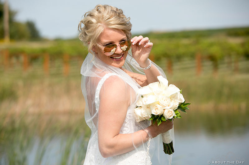 The beautiful bride poses with sunglasses at DC Estate Winery