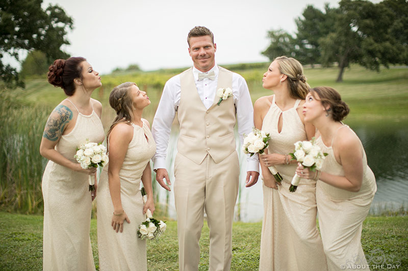 Brent poses with the bridesmaids