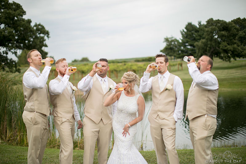 The Bride has a drink with the Groomsmen