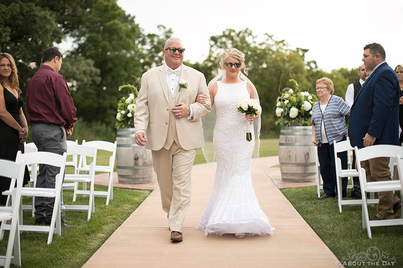 Heather and her father walk down the isle at DC Estate Winery