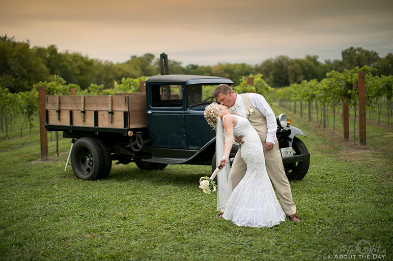 Bride and Groom do a big kiss in front of old ford truck at DC Estate Winery