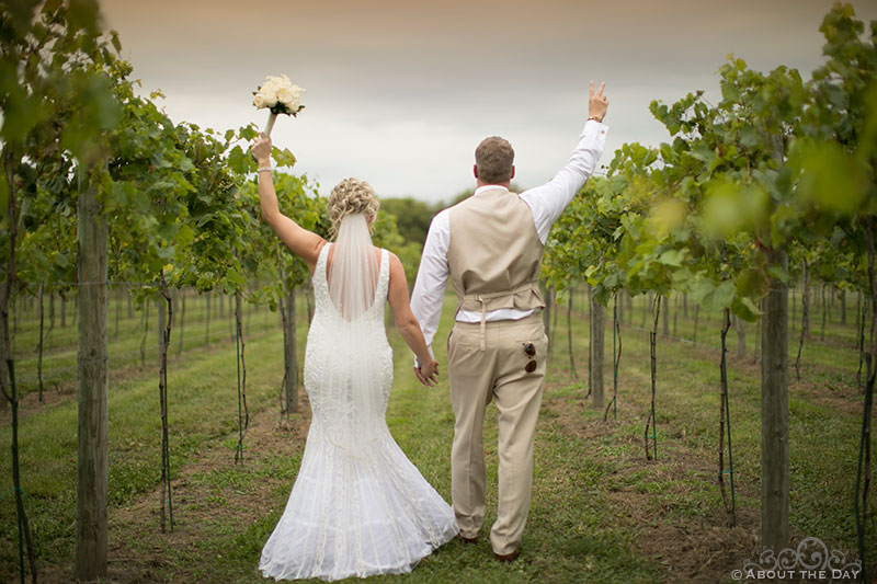 Brent and Heather celebrate in the rows of grapes at DC Estate Winery
