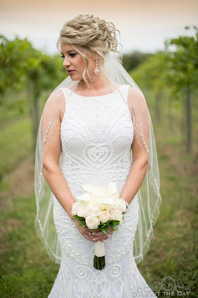 Heather the Bride in the rows of wine grapes