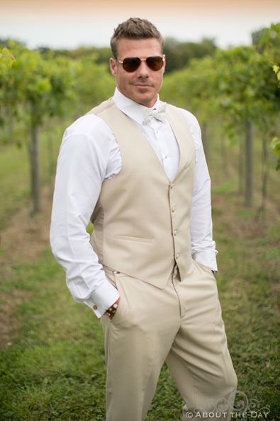 Brent the Groom in the rows of wine grapes