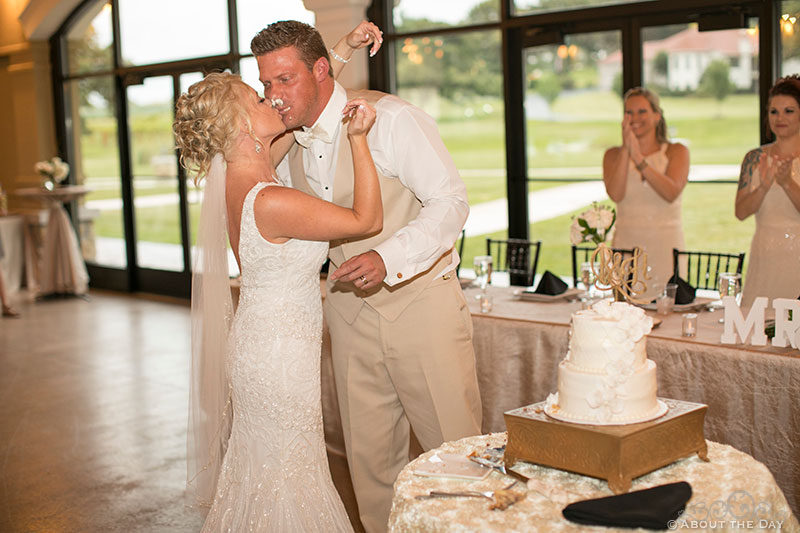 Kissing after a small wedding cake fight