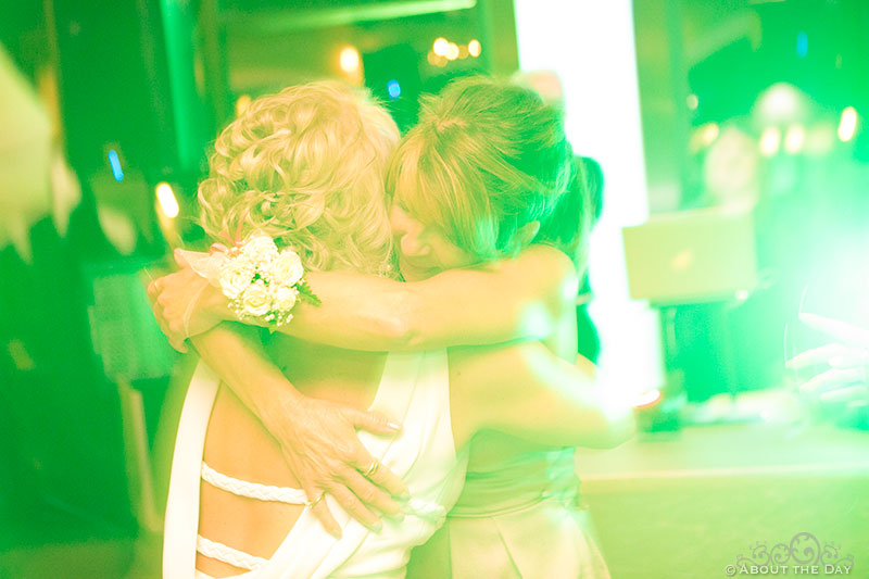 Heather and her mom hug in the green lights