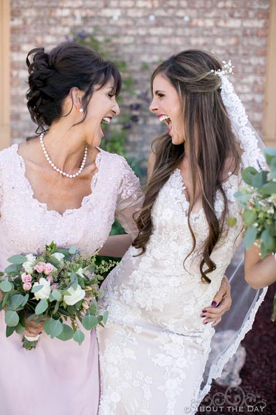 Bride and her mother laughing
