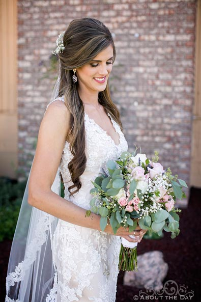 Gorgeous Bride poses with her bouquet
