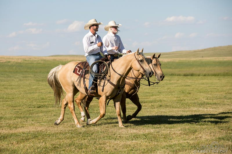 Cowboys ride horses to start wedding ceremony at Haythorn Land & Cattle Co