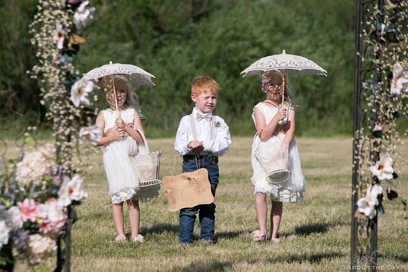 Flower girls and ring boy enter wedding ceremony