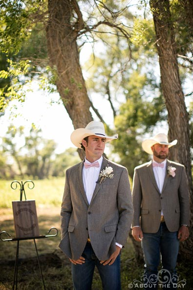 Cowboy Groom looks on as Bride comes down the isle at Haythorn Land & Cattle Co