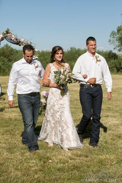 Beautiful Bride is escorted down the isle by her two brothers
