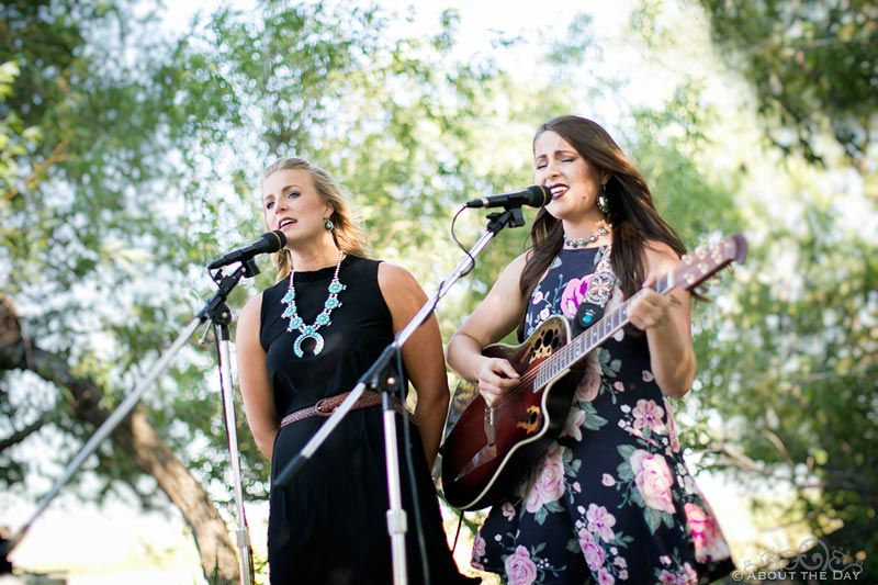 Pretty girls sing country song during wedding ceremony