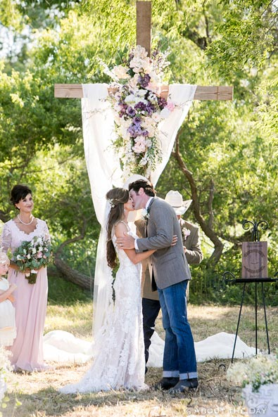 Bride and Groom kiss during country wedding ceremony