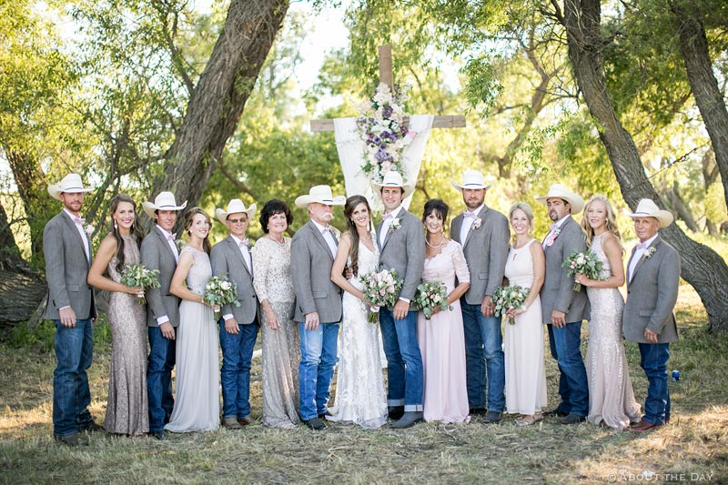 Cowboys and wedding party with Bride and Groom