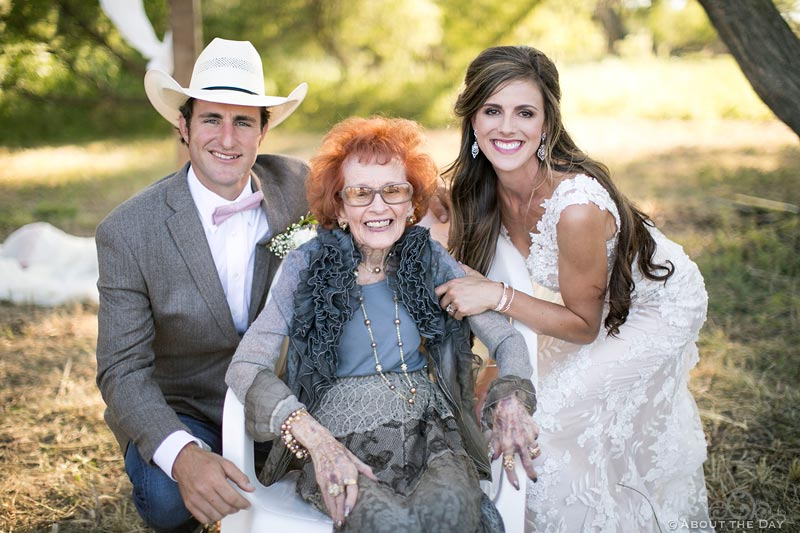 Bride and Groom pose with Grandma