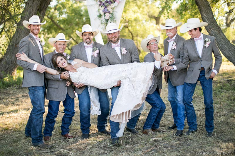 Lovely Bride being lifted by the Groomsmen