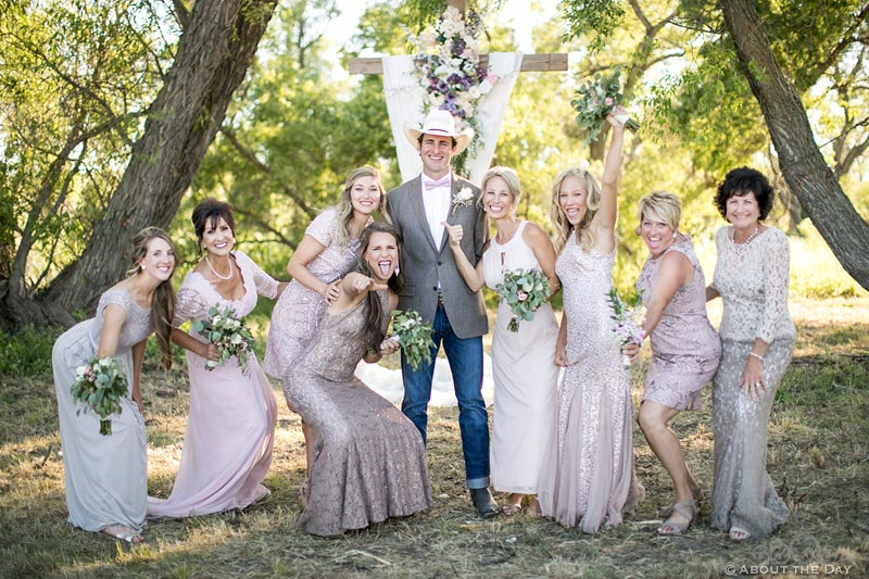 Cowboy Groom being goofy with the bridesmaids