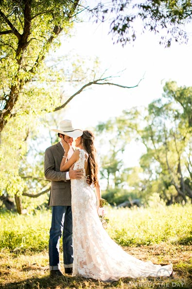 Bride and Groom kiss in sunlit trees