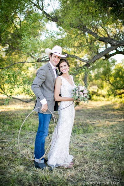 Cowboy Groom uses rope to bring Bride closer
