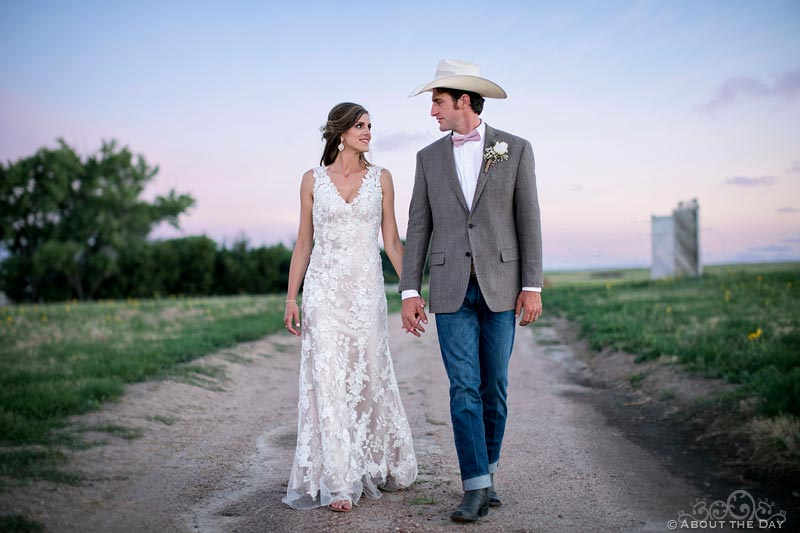 Bride and Groom walking after sundown at Haythorn Land & Cattle Co