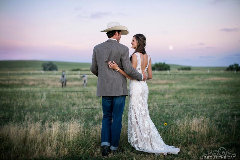 Bride and Groom at moonrise with horses at Haythorn Land & Cattle Co