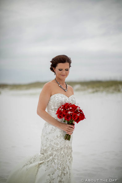 Beautiful Bride with red rose boquet on Princess Beach in Destin, Fl